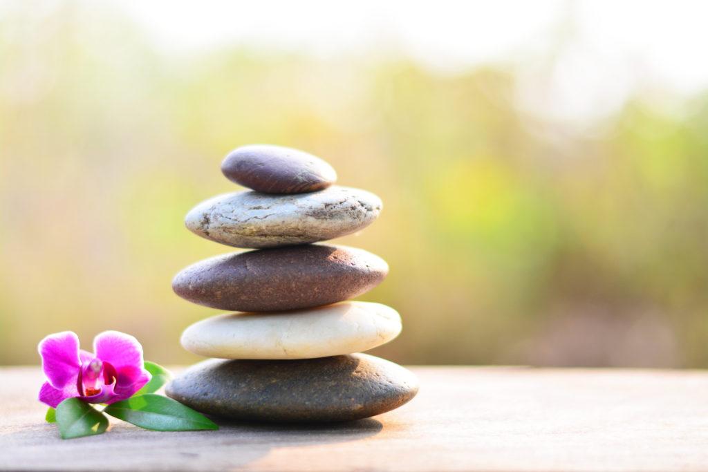 Zen stones and vanda orchid on wooden floor right space position.